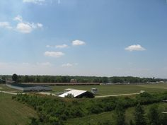 """A view of the ranges at Camp Perry from the Range Tower. CMP Air Gun Range on the left, with the Petrarca Range (covered) in the middle and the traditional home of the smallbore national matches on the right. (The """"How-To"""" Gun Girl photo) National Championship, Traditional House, Ranges, Girl Photos, Guns, Middle, Tower, Country Roads, Explore"""