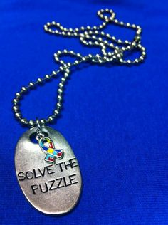 """This month is Autism Awareness and I want to share this amazing piece of jewelry from JK that shows your support..you can add the support ribbon JK offers and a blue crystal! I will personally donate 10% of my sales for this jack tag, ribbon and crystal this month to help """"Solve the Puzzle""""! Please message me with any questions (this is the Jack Tag comes with necklace and tag for $26 you can also add support ribbon is $10 and blue crystal is $8)www.jewelkade.com/tammyh"""