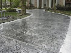Grey coloring and stamping - Custom Concrete Solutions