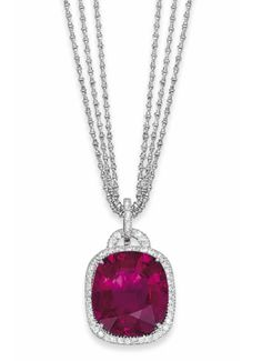 A TOURMALINE AND DIAMOND PENDANT NECKLACE   The large cushion shaped pink tourmaline claw-set to the pavé-set circular-cut diamond surround, gallery and pendant loop, suspended from a triple row fancy-link neckchain