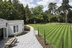 The house, off East Road on the prestigious St George's Hill estate, took two years to build. The trees and plants were specially imported from Tuscany