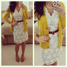 Cream lace dress, brown belt, yellow cardigan.