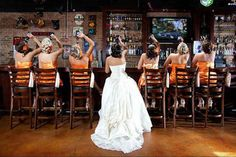 A shot with them at the bar...literally. | 42 Impossibly Fun Wedding Photo Ideas You'll Want To Steal