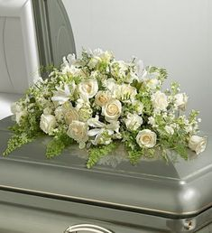 White Rememberence Casket Spray ~ I love the roses but you can save money by using carnations!  :)
