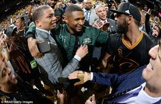 Usher (centre) was at Oracle Arena to celebrate alongside Cleveland Cavaliers head coach Tyronn Lue (left)