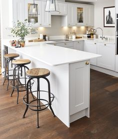 Mollie transformed her open-plan room into a stylish, multi-functional grey kitchen. We love this industrial look, featuring pendant lights, industrial bar stools, dark flooring and Silestone White Quartz Worktop. White Kitchen Worktop, Dark Kitchen Floors, Beige Kitchen, Kitchen Flooring, Dark Flooring, Kitchen Stools, Kitchen Cabinets, Open Plan Kitchen Dining Living, Open Plan Kitchen Diner