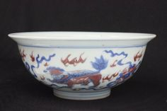 """Kangxi blue & white copper red bowl Depicting """"Dancing Beast"""". Approx. 3"""" H, 7"""" D."""