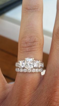 Brilliant elongated cushion cut, three-stone engagement ring with pave wedding band