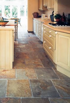 Reminds me of the slate floor in our old farmhouse. Beautiful & full of character!