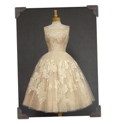 Beautiful 1950's dress. Another that I would love to wear, on a wedding day or on a daily basis.