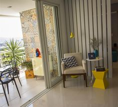 Living / Varanda / Sala de Leitura / Sala de estar - Projeto By UNE CASA Arquitetura