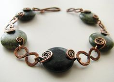Genuine Russian serpentine surrounded by copper coils and hammered s-links