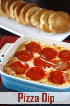 Pizza Dip:::Super-amazing delicious, the super bowl party polished a double serving off in 20 minutes!! Note: I cut the amount of tomato sauce in half, and served them with homemade pizza rolls (pizza dough baked with herbs in tiny balls)