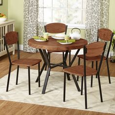This five-piece dining set has a simple but homey feel featuring an expresso reclaimed look.