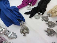 scarf with jewelry attached, pendant charm scarf necklace with mixed designs of pendants $3.45 - http://www.wholesalesarong.com/blog/scarf-with-jewelry-attached-pendant-charm-scarf-necklace-with-mixed-designs-of-pendants-3-45/