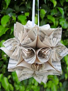 From Tara Ackerman via Etsy. I could see this done with old books or sheet music, with edges inked for an aged look.