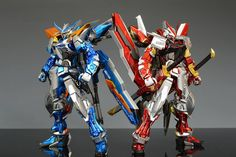 Blue flame astray  red flame astray dont know who made the picture or the gunpla but i love them.