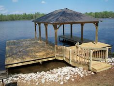 My husband loves to go out on the lake and recently bought us a boat so we could. I think getting a custom dock like this would be a great idea. It would be a nice place to hold our new boat and have our own place to enjoy the lake! Lake Dock, Boat Dock, Lake Landscaping, Costa, Farm Pond, Deck Over, Lakefront Property, Custom Decks, Yard Design