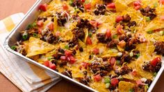 Keep the heat outside with munchy nachos. A foil pan takes them from grill to picnic table in just minutes. ~~~~~~~~~~~~~~~~~~~~~~~~~~~~~~~~~~~~~~~ I think I would make up some taco meat ahead of time and use it instead of the black beans.