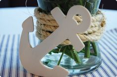 Cute nautical accents to bottom of vases for rehearsal dinner