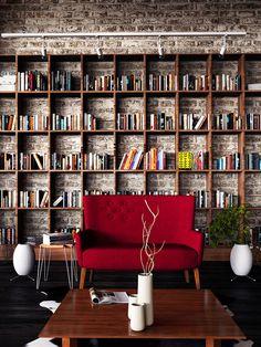 Stunning bookcase. bricks wall.