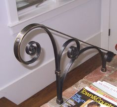 Iron hand rail with bronze cap
