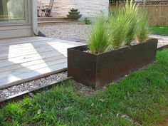 Steel planter with short grasses to line front seating area? Low Water Landscaping, Outdoor Landscaping, Landscaping Ideas, Ornamental Grass Landscape, Ornamental Grasses, Side Garden, Garden Paths, Fence Planters, Planter Beds