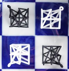 NEW! Knight's Tour Earrings  On a chessboard, a knight moves diagonally along a path shaped like an L. These earrings take knight moves into the third dimension.  This coordinated pair contains two tours of knight moves in a 3x3x3 cube.    #threedimensional #chess #chessjewelry #mathjewelry #knight #knighttours  #3dchess #cube #blackandwhite #3dprinting #abstract #abstractart #geekjewelry #nyclife #nycjewelry #nycxdesign #wireframe #nyc #hanusadesign #nycfashion
