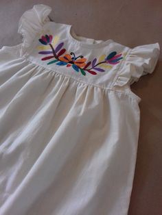 Dress for girls with Otomi embroidery by Tenango. Frocks For Girls, Kids Frocks, Embroidered Vans, Cute Girl Dresses, Mexican Dresses, Embroidery Dress, Baby Embroidery, Mexican Style, Dress Patterns