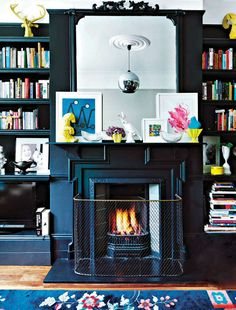 fireplace + book shelves - pictures on the mantle (too cluttered)