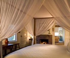 Love the look of this cozy bed & the fireplace-now this is my perfect dream Bedroom!!