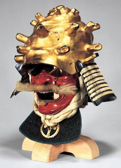 Kabuto (helmet) in the shape of a turban shell, with gold leaf, Momoyama period, 17th century, Iron, gold, lacquer, and silk, H. of bowl, 19.3 cm, Tokyo National Museum.