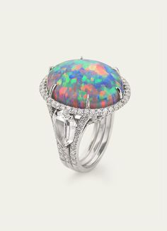Black Opal and diamond ring set in platinum