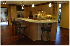 want to make the basement feel more like a gathering place, which seems to be around the kitchen island in any house i ever go to -- would just need bar to be a bigger island, but like the idea of chairs on one side