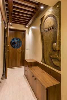 Buddha face: artwork by istudio architecture Foyer Design, Lobby Design, Main Door Design, Entrance Design, Home Entrance Decor, Apartment Entrance, Apartment Walls, House Entrance, Apartment Interior