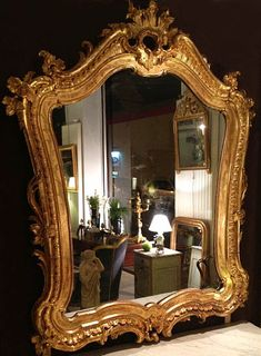 Rare, French, Rocaille style mirror: In solid, carved giltwood.  First half of the 19th century.
