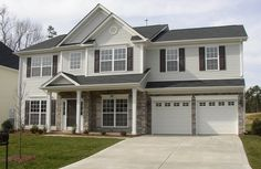Color scheme. Light gray siding. White garage doors and trim. Gray stone with some beige in it, dark gray roof and door. http://color4charlotte.files.wordpress.com/2012/07/new-house.jpg