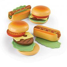 Hape - Hamburgers and Hotdogs: Serve hamburgers and hotdogs for a quick meal or backyard BBQ. Don't forget the mustard and tomato sauce! Delicious fast food. Set includes two each: hamburger bun top and bottom, hot dog bun, hamburger patty, hot dog, lettuce, cheese and tomato. #alltotstreasures #pretendplay #hapehamburger #hapehotdog #hapeimaginativeplay #hapefood