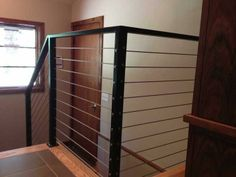 "Custom interior cable railing with 3/16"" stainless steel cables and iron framework."