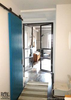 Sliding barn door hardware with awesome blue door.