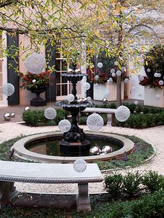Add Unexpected Sparkle Outdoors      Metal-mesh spheres hung by fine wire from the trees create a magical effect in the Blair House courtyard. Large stainless-steel orbs rest on the ground like pieces of contemporary sculpture, carrying the ornament motif from the tabletops, fountain, and urns to the ground.
