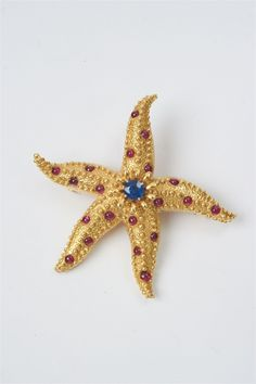 """Tiffany Studios New York New York, 1980s/1990s.An 18k gold, ruby and sapphire """"Starfish"""" clip brooch by Tiffany & Co with design by Jean Schlumberger, Auction 1066 Decorative Arts, Lot 239"""