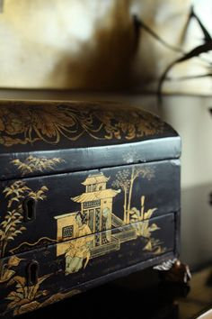 Chinoiserie Chic. I love this black enameled jewelry box. I used to have one rather like it. I like these a LOT!