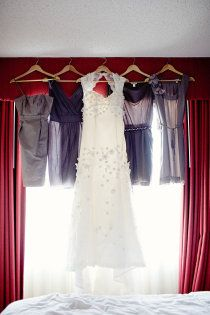 Gorgeous picture of the wedding dress and the BM dresses.