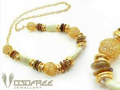 Winner will receive this Long Pearly Lucite and Gold Wire Mesh Beaded Necklace - International Giveaway