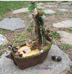Fairy House Boat - this would be cute moored at the edge of a garden pond. Now my grandsons would like this.not too 'girly' as the older one says lol Mini Fairy Garden, Fairy Garden Houses, Dream Garden, Garden Pond, Fairy Gardening, Terrariums, Fairy Village, Fairy Garden Furniture, Fairy Garden Accessories
