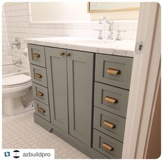 This guest bath by @AZ Buildpro has us swooning! We love the dark vanity, marble slab, and brass hardware with our Luxe White Octagon and Subway White tile. https://www.arizonatile.com/en/products/mosaics/porcelain-mosaics/luxe-octagon#utm_sguid=149397,42ee5adb-95b6-3f97-1d44-6584992eaa7f