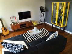 Living room. #stockholm #ikea #HAY #HAYtray #living #room #sofa #interior #design #carpet #guitar #yellow #grey #black #white