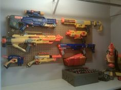 Peg board to organize nerf guns. (basement)  That might work!  Think they would actually hang them back up???