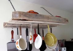 Add some more hanging space to organize your utensils in your kitchen. Simply nail in the pallet crate into your kitchen wall suspended with the help of supporting chains. Add as many hooks as possible to hang your utensils most frequently used on daily basis.